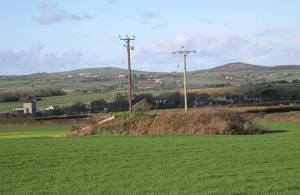 Telegraph Poles on Mine Rubble