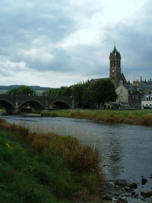 Parish church and wishing well viewed from the banks of the River Tweed