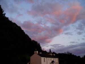 Sunset sky over cottages at Satterthwaite