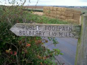 Footpath sign at Rew Cross