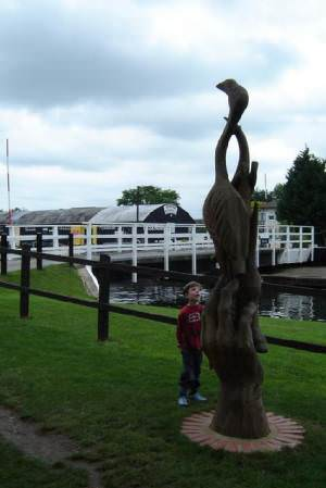 Wooden sculpture, by the swing bridge