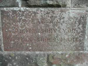 Dedication stone on bridge