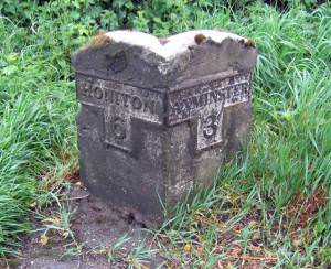 Old stone milepost on the A35