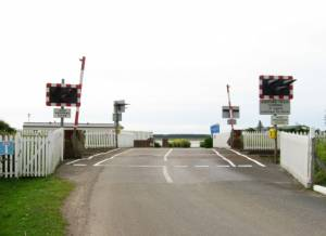 Level crossing and entrance to Carmarthen Bay Holiday Park